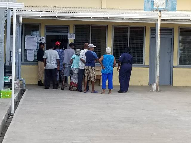 Persons queueing to cast their vote at the Lower Corentyne Secondary School.