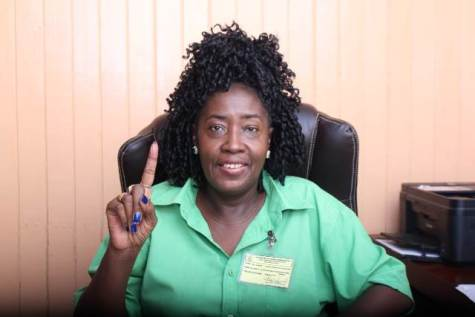 Minister within the Ministry of Communities, Valerie Adams-Yearwood displays her inked finger to show she voted at the LGE.