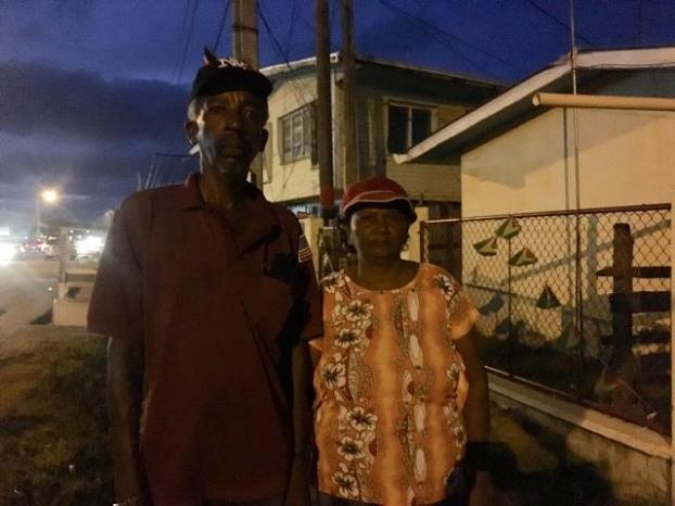 Last to vote! Mr.Cecil Fraser and his wife leaves the Rose Hall Town Primary School as the final persons to vote.