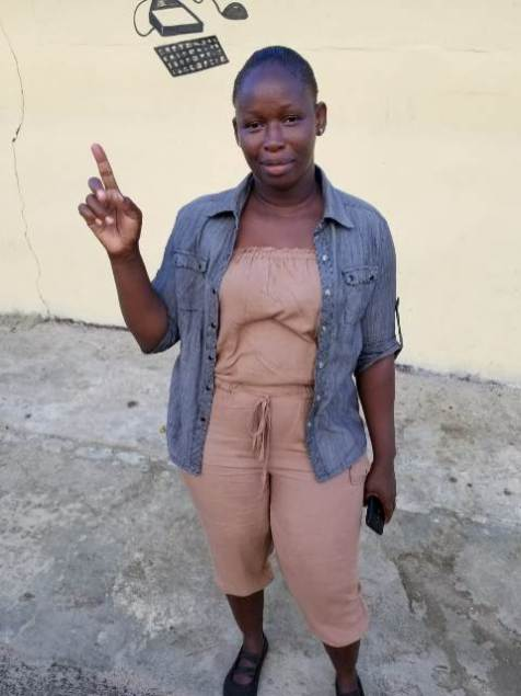 Rose Hall resident, Onica McPherson, showing her inked finger, was the second person to vote at the Rose Hall Primary School polling station.