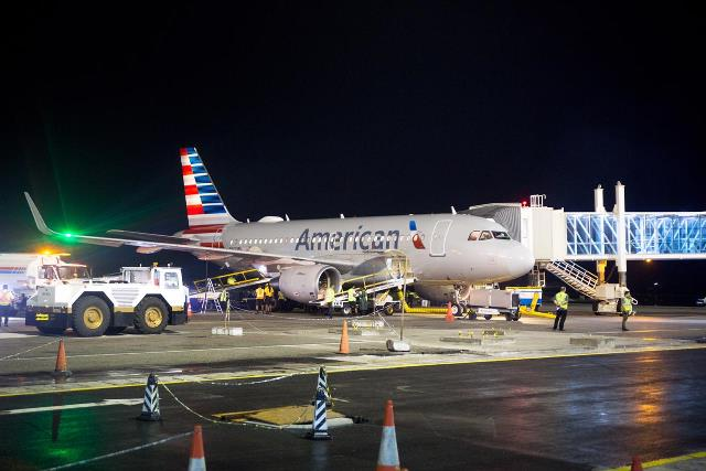 American Airlines aircraft joining to the boarding bridge.