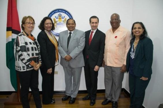 Prime Minister and Minister of Finance Winston Jordan with Mrs. Tahseen Sayed Mr. Jorge Familiar Mrs. Galina Sotirova Mrs Abha Prasad, Mr. Federico Baechili.