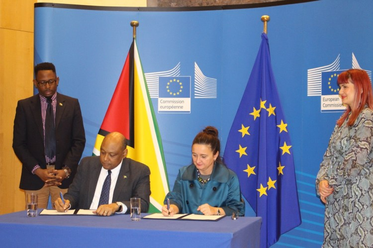 Minister of Natural Resources Hon. Raphael G.C Trotman initialling on behalf of The Co-operative Republic of Guyana, and Directorate-General for International Cooperation and Development (DG DEVCO) Deputy Director-General Marjeta Jager initialling on behalf of the European Union