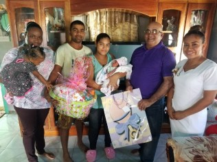 REO Jaikaran presents a hamper to the family of baby Azaria Evelyn.