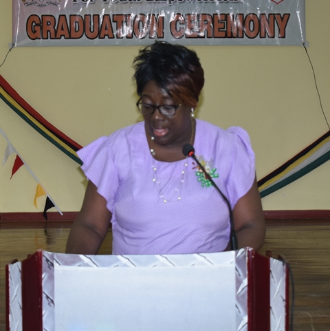 REDO Lewis addressing graduates.