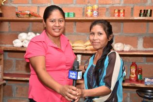 Two friends of Kumu Village at their grocery shop