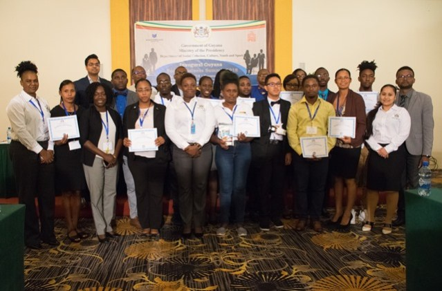 Director of Youth, Melissa Carmichael-Haynes [centre] Assistant Director of Youth Leslyn Boyce [far left] along with the youths who were afforded grants at the Youth Business Summit back in May.
