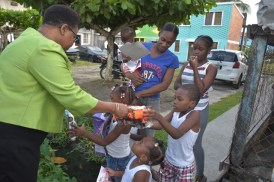Along Laing Avenue, Minister Lawrence met this family of two boys and three girls whom she presented with toys.