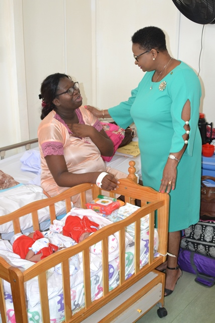Mother of Christmas Eve twins, interacts with minister Lawrence.