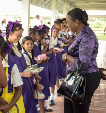 Minister of Education Dr. Dr. Nicolette Henry engages students as she arrives at President's College