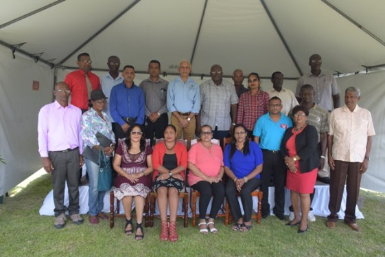 Minister of Communities, Ronald Bulkan along with the Region 2 NDC chairpersons and deputies.