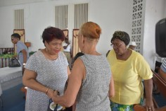 Minister of Social Protection, Amna Ally presents hampers to some of the recipients at Franklin Talbot Memorial A.M.E. Church and Burnham Mausoleum.