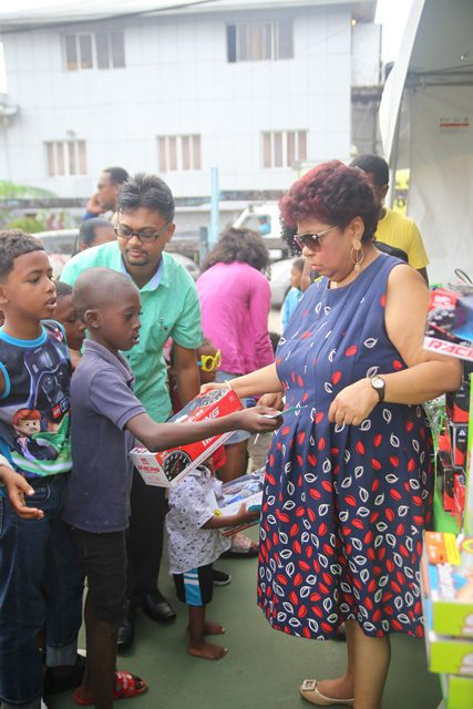 Minister of Social Protection, Amna Ally sharing gifts to the little ones in Alberttown.