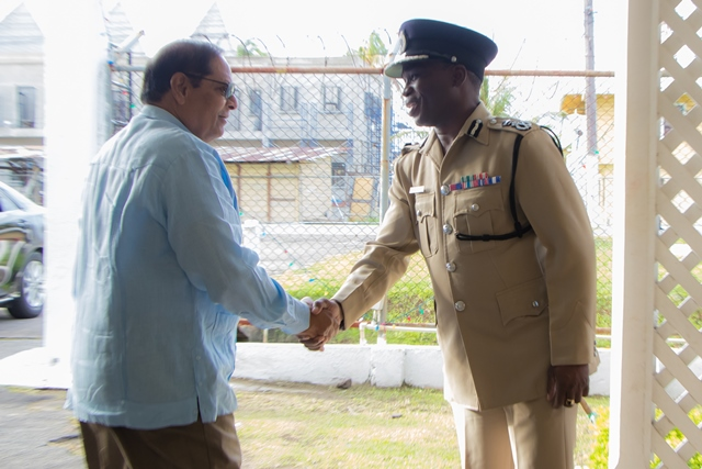 Prime Minister Moses Nagamooto is greeted by Commissioner of Police Leslie James DSS as he arrives at the annual Police Officers' Christmas Breakfast at Eve Leary.