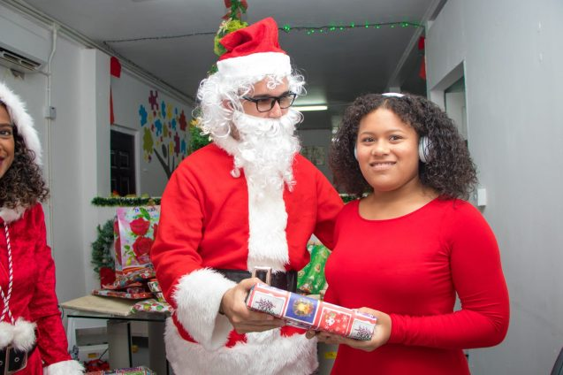 Receiving her gift from Santa Claus