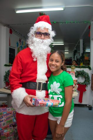 One of the children receiving her gift from Santa Claus