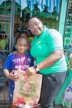 Minister Broomes with young lad, after receiving his gift.