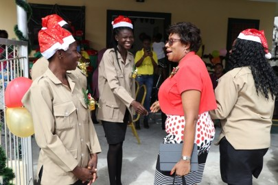 Minister of Public Telecommunications, Catherine Hughes is greeted by the staff of the GPOC.