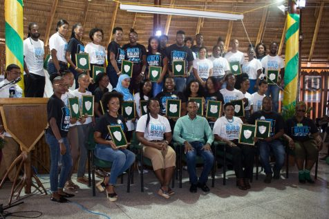 (front row seated second from left) Director of Youth Melissa Carmichael, and Alder Bynoe, Liaison Officer, UNFPA and the awardees