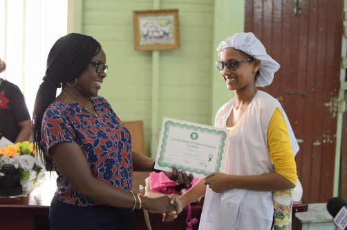 Erica Boodoo receiving her certificate from Deputy Chief Medical Officer, (DCEO) Dr. Karen Campbell