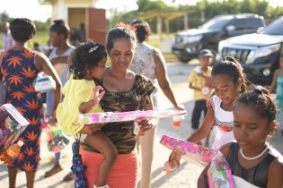 The overjoyed children after receiving their gifts as part of the Minister of Social Protection's Christmas Toy Drive.
