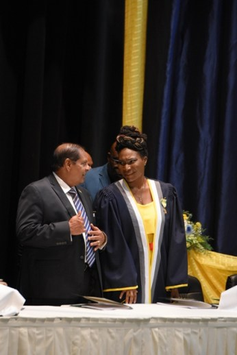 Prime Minister, Moses Nagamootoo and Principal of the Cyril Potter College of Education (CPCE), Viola Rowe sharing a light moment at the graduation exercise.