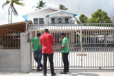 Officers of the EPA calling on a Lusignan farmer before conducting an inspection of his operations.