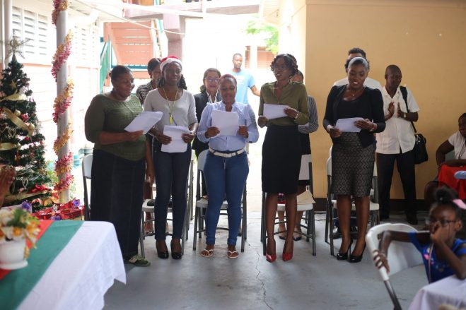 Staff from Attorney General Chambers sing Christmas Carols