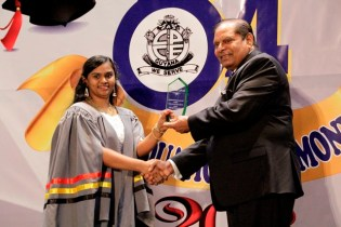 Best Graduating Student, Ms. Annamarie Isserdeen Samaroo receiving the Prime Minister's Prize from Prime Minister, Hon. Moses V. Nagamootoo.