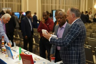 Attendees visiting the booths.
