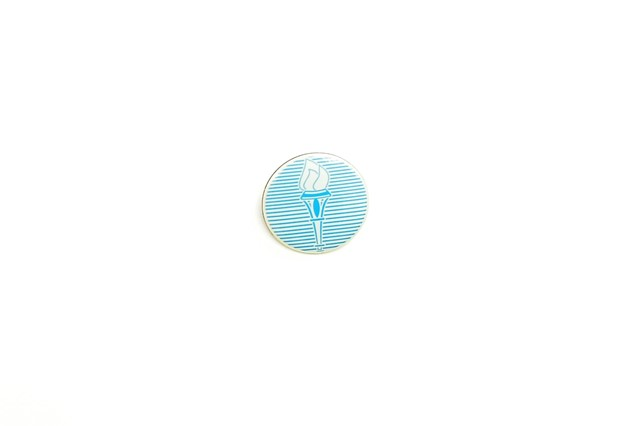 The lapel pin distributed by President David Granger on Sunday at his annual media brunch.