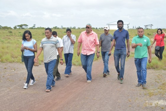GWI officials and Fly Hill villagers led by Dr. Van West-Charles and Toshao Mr. Russian Dorrick in Fly Hill, Reg 9.