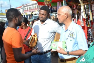 Minister of Communities Ronald Bulkan interacts with citizens.