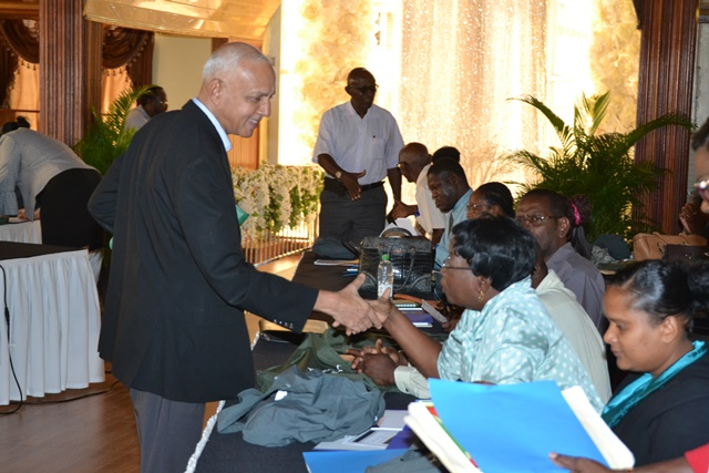 Minister of Communities, Ronald Bulkan greets participant at the conference.