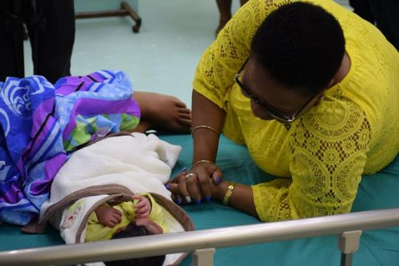 Minister Lawrence interacts with the New Year's Day baby at GPHC.