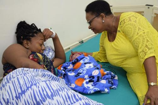Minister Lawrence visiting other mothers and their babies who were delivered on New Year's Day.