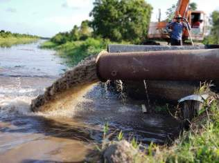 Water being pumped from Dredge Creek into the Somerset and Burks Main Cross Canal.