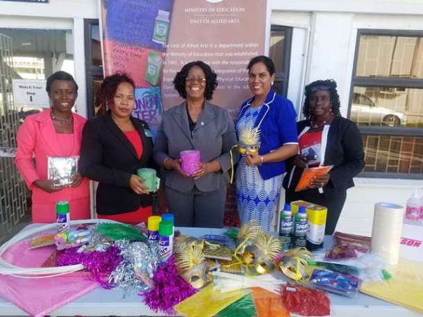 Administrator of the Allied Arts Unit, Ms. Lorraine Barker-King (centre) along with the teachers of the four schools at yesterday's handing-over.