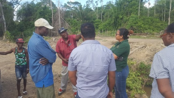 NDIA team members interact with some East Bank Berbice farmers.