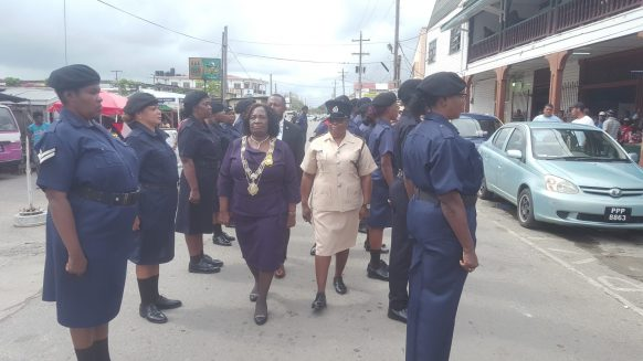 Mayor Winifred Haywood inspects constables of the New Amsterdam Municipality's constabulary minutes before commencing the January 2019 statutory meeting