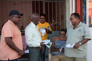 Minister within the Ministry of Social Protection Keith Scott interacting with the people.