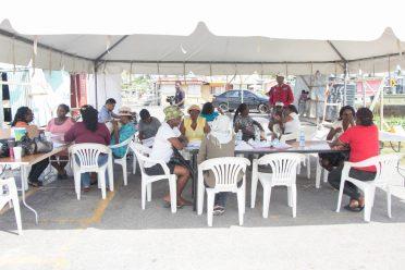 Community Development Officers registering applicants on spot