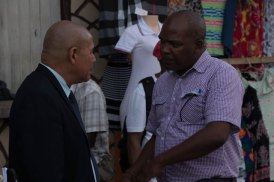 Minister of Social Cohesion, Dr. George Norton speaking to residents, as he took a walk in Linden's market.