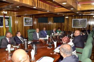 President David Granger, Ministers of Government and members of the Opposition during the meeting at the Ministry of the Presidency.