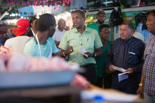 Minister of Indigenous Peoples' Affairs, Sydney Allicock and Deputy Mayor of Georgetown, Alfred Mentore interacting with stall-holders in Bourda Market.