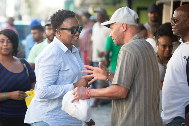 Minister within the Ministry of Public Infrastructure, Anette Ferguson chatting with resident at the Bourda Market.