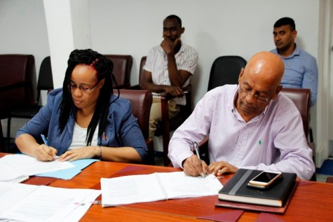 Permanent Secretary of the Ministry of Education, Ms. Adele Clarke and Vikab Managing Director, Mr. Hardat Punwasee signing the contracts today.