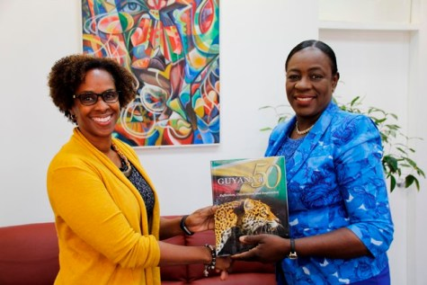 Minister of Education, Dr. the Hon. Nicolette Henry presents the new FAO Representative to Guyana, Dr. Gillian Smith with a record of Guyana's History.