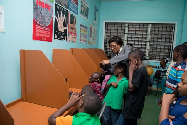 Minister of Public Telecommunications, Catherine Hughes interacts with some of the children who will frequently use the ICT Hub.