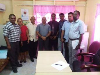 REO Jaikaran with members of the Mayor and Town Council of Anna Regina.